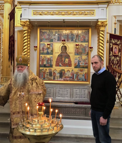 Archbishop Peter by the icon of St. John Kochurov. On the right is the great-grandson of St. John Kochurov.